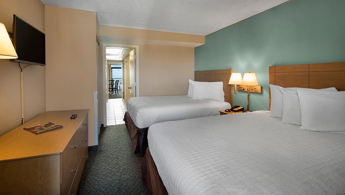 Landmark Resort Deluxe Oceanfront Suite Bedroom