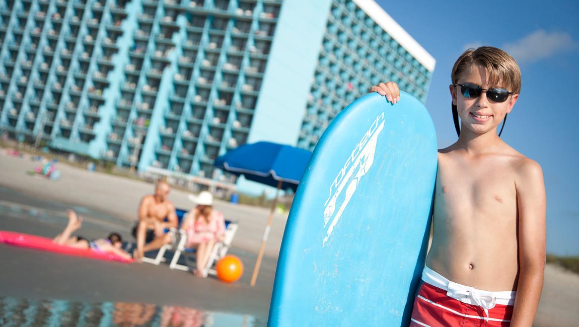 boy with skim board