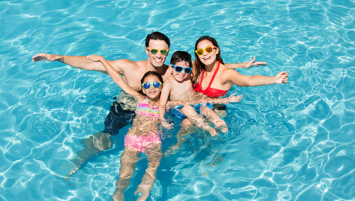 Family in the outdoor pool
