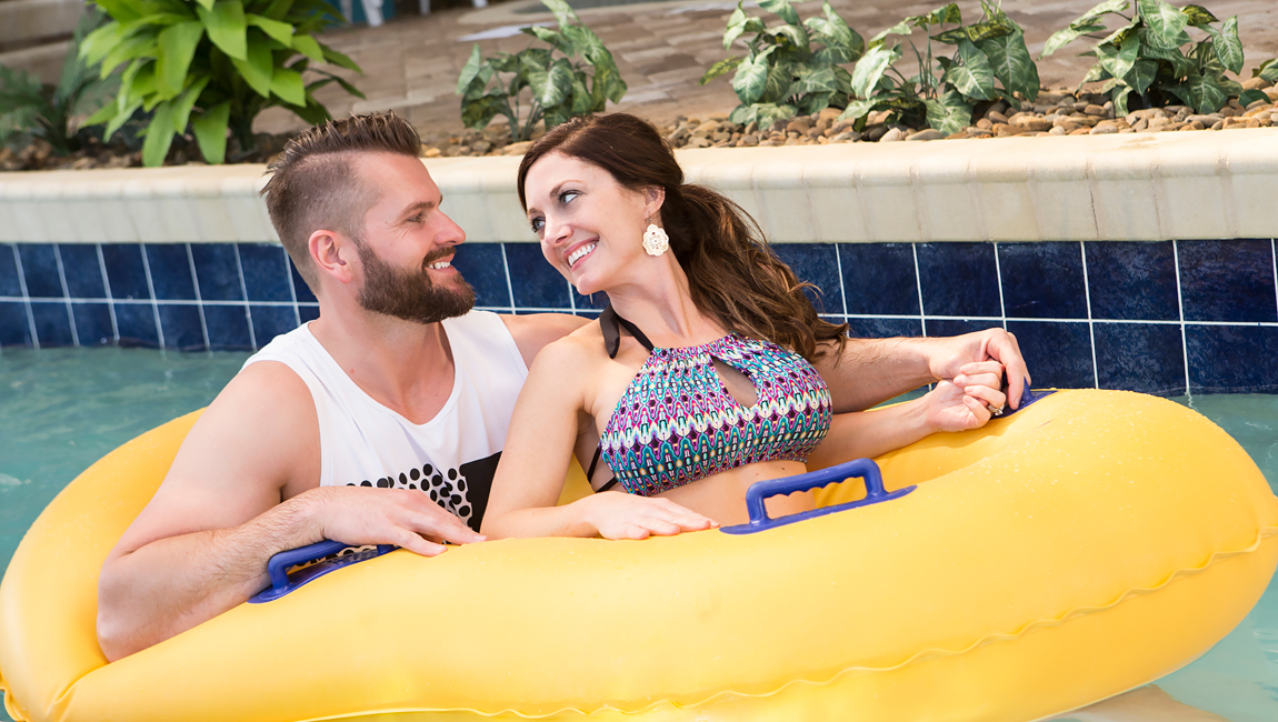 Couple floating in lazy river