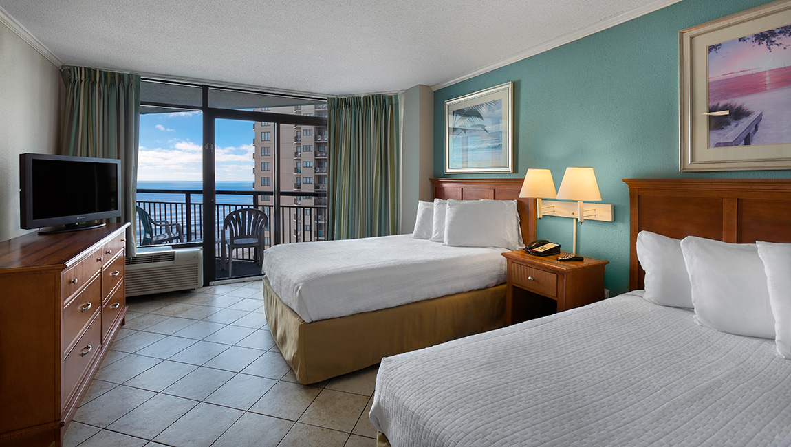 deluxe angle oceanfront suite Myrtle Beach bedroom at landmark resort